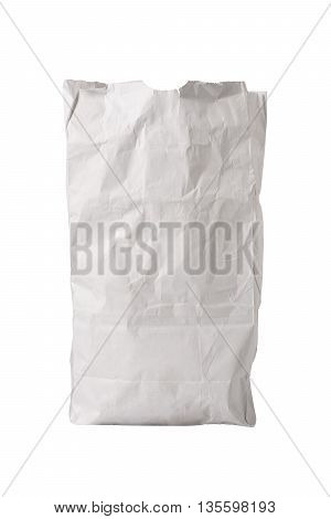 A small white paper bag wrinkled with some grease spots possibly for fast food sitting upright isolated on white