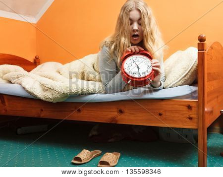 Woman Waking Up Late Turning Off Alarm Clock.