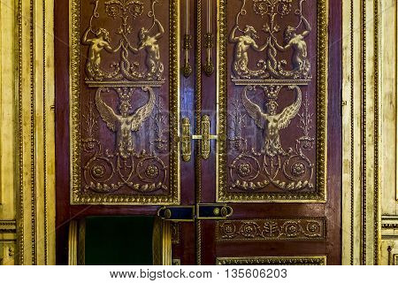 FONTAINBLEAU, FRANCE - MAY 16, 2015: This is fragment door wardrobe with carved inlay.