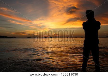 Silhouette Of Photographer At Sunset On The Beach
