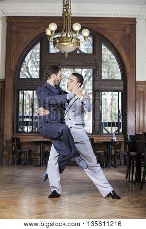 Tango Dancer Lifting Male Partner In Restaurant