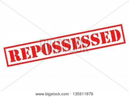 REPOSSESSED red Rubber Stamp over a white background.