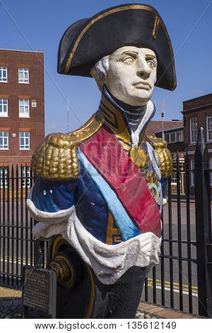 A monument of Lord Nelson located in the historic dockyard in Portsmouth UK.