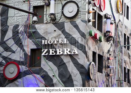 TOKYO, JAPAN - June 23 2016: The kitsch exterior of the Love Hotel Zebra in Ikebukuro. Tokyo is famous for love hotels that can be rented by the hour. In Tokyo, Japan 2016