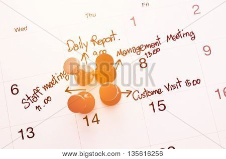 Pushpin on calendar with busy day overworked schedule with filter.