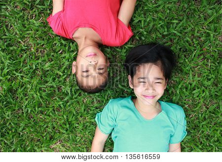 Two lovely kids with green grass background.