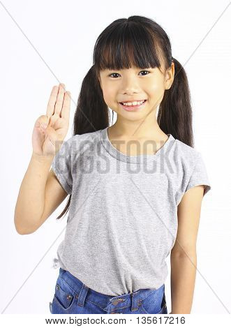 Portrait of young cute girl posting with three fingers isolated on white