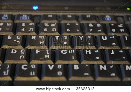Black old and dusty Thai-Eng keyboard background