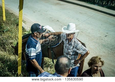 Trinidad Cuba - January 13 2016: Trinidad's residents still use horses for transportation. Cuba has one of lowest vehicle per capita rates in the world. In Cuba sits the local cowboys Gaucho in the saddle all day. They are a regular part of the local life
