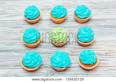Cupcakes with green and blue cream flat lay