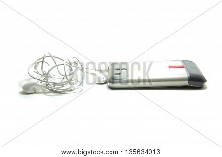 Cellphone and Earpiece Headset on white background