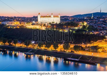BRATISLAVA SLOVAKIA - 29TH APRIL 2016: A view towards Bratislava Castle at twilight. The building can be seen lit up.