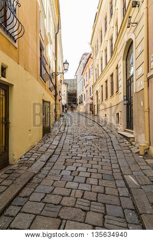 BRATISLAVA SLOVAKIA - 29th April 2016: Old streets in Bratislava during the day showing buildings and cobbled streets. People can be seen.