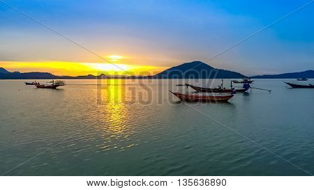 Long tail boat on beach on sunset on ebb. Thailand