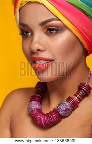 Afro American Young Woman Wearing A Turban And Necklace