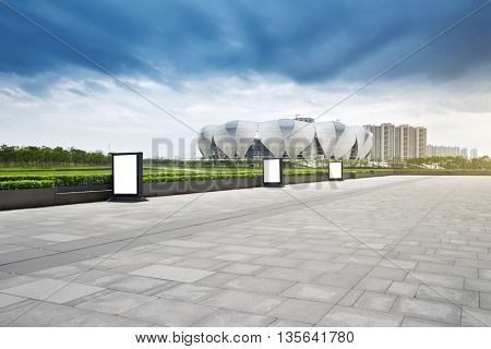 hangzhou,china:hangzhou new stadium in cloud sky on view from empty marble floor by zhudifeng on Jun 4 2016