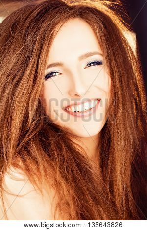 Smiling beautiful Woman with Red Hair and sunlight