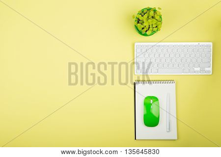 Wireless Slim White Keyboard And Green Mouse, Notepad, Flower On Yellow