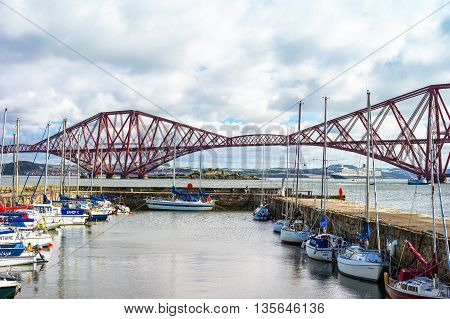 South Queenferry Scotland - July 29 2012: Lothian area the Forth Rail Bridge seen from harbor