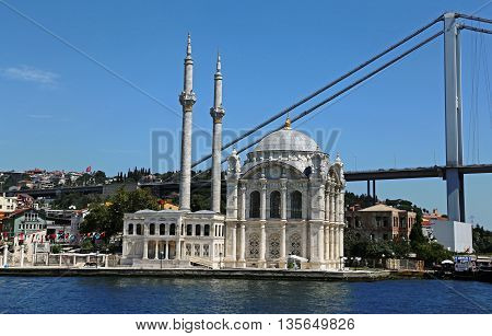 ISTANBUL, TURKEY - AUGUST 14, 2015: Ortaköy Mosque shot  from the Bosphorus.  It was completed in 1856.