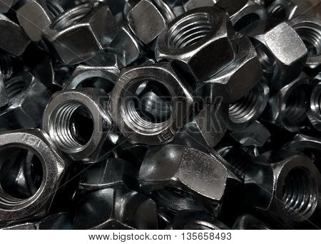 Hex screw nuts in box at the hardware shop