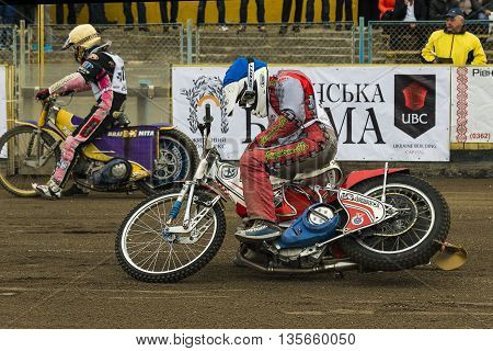 Rivne Ukraine - 11 October 2015: Unknown riders prepares for the start at the Open Cup Speedway to the day of the city Rivne