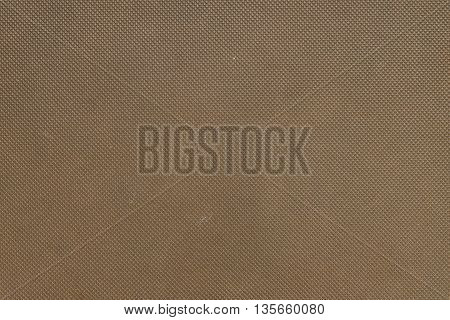 Closeup at front cover of brown note book background