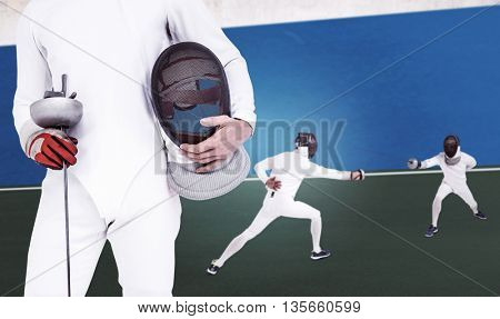 Swordsman holding fencing mask and sword against digitally generated image of bi colored background