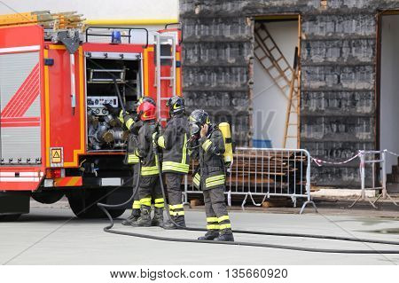 Firefighters With Breathing Apparatus During The Exercise In Fir