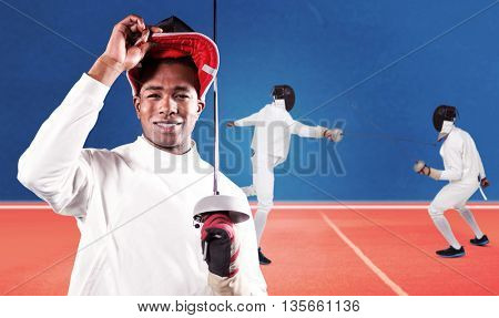 Portrait of swordsman standing with fencing mask and sword against digitally generated image of tracks