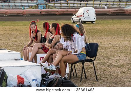 Rivne Ukraine - 29 August 2015: Pit lane girls getting ready for a competition on the Open Cup Speedway to the day of the city Rivne