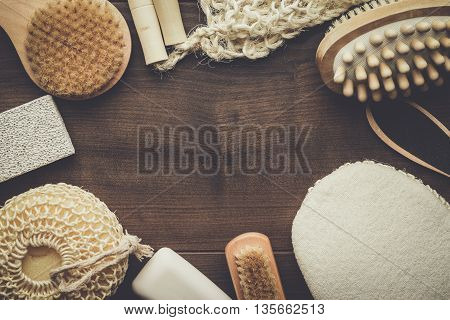 some bath accessories on the brown wooden background