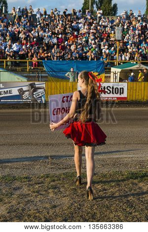 Rivne Ukraine - 29 August 2015: Pit lane girl getting ready for a competition on the Open Cup Speedway to the day of the city Rivne