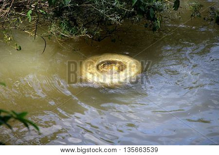 a garbage  submerged by flood water june 2016