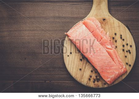 salted trout on the hardboard kitchen table
