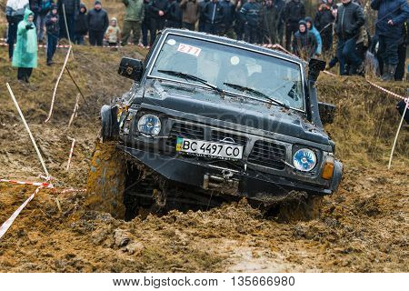 Lviv Ukraine - February 21 2016: Off-road vehicle brand Nissan (No. 277) overcomes the track on a amateur competitions Trial near the city Lviv Ukraine