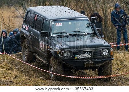 Lviv Ukraine - February 21 2016: Off-road vehicle brand Nissan (No. 277) overcomes the track on at amateur competitions Trial near the city Lviv Ukraine