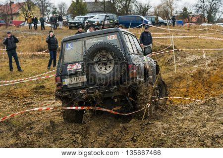 Lviv Ukraine - February 21 2016: Off-road vehicle brand Nissan (No. 209) overcomes the track on at amateur competitions Trial near the city Lviv Ukraine