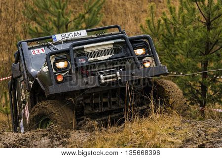 Lviv Ukraine - February 21 2016: Off-road vehicle UAZ (No. 221) overcomes the track using winch on landfill near the city Lviv.