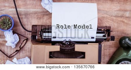Role model message against above view of typewriter and old phone