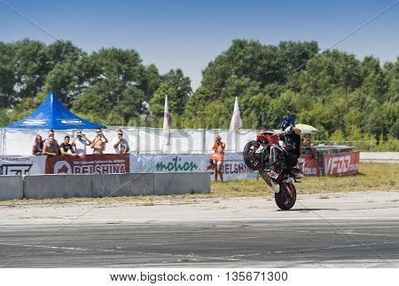 Vinnytsia Ukraine-July 25 2015: Unknown stunt biker entertain the audience before the start of the championship of drifting on July 25 2015 in Vinnytsia Ukraine.