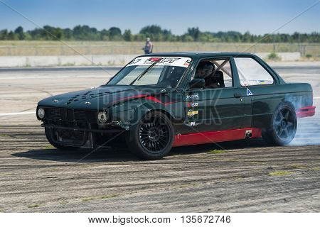Vinnytsia Ukraine-July 24 2015: Rider Alexey Kosogov on the car brand BMW overcomes the track in the Drift championship of Ukraine on July 242015 in Vinnytsia Ukraine.