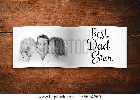 Attractive smiling father with his child against overhead of wooden planks