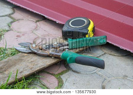 tinsmith tools, metal scissors and tape measure