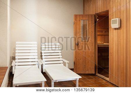 two deckchairs  of a sauna, interior