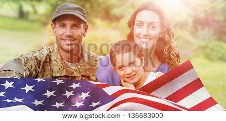 Portrait of army man with family against focus on usa flag