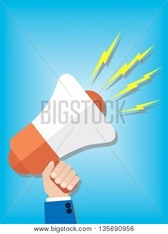 A men's hand holding a colored megaphone
