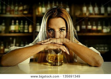 drunk woman alone in wasted and depressed face expression leaning on scotch whiskey glass isolated at bar or pub in alcohol abuse and alcoholic housewife concept