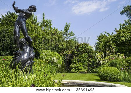 Hylas and the Nymph statue located in the beautiful St. Johns Lodge Gardens in Regents Park London.