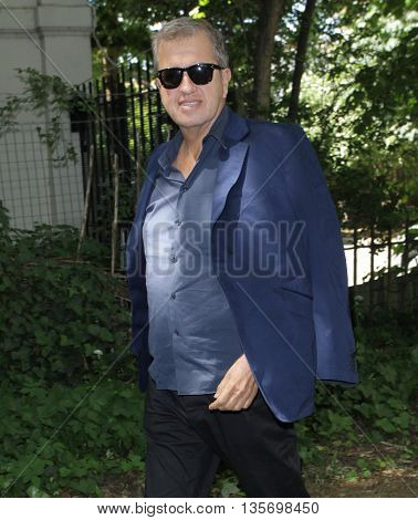 LONDON, UK, JUNE 15, 2015: Mario Testino attends the Burberry Prorsum fashion show London Collections picture taken from the street